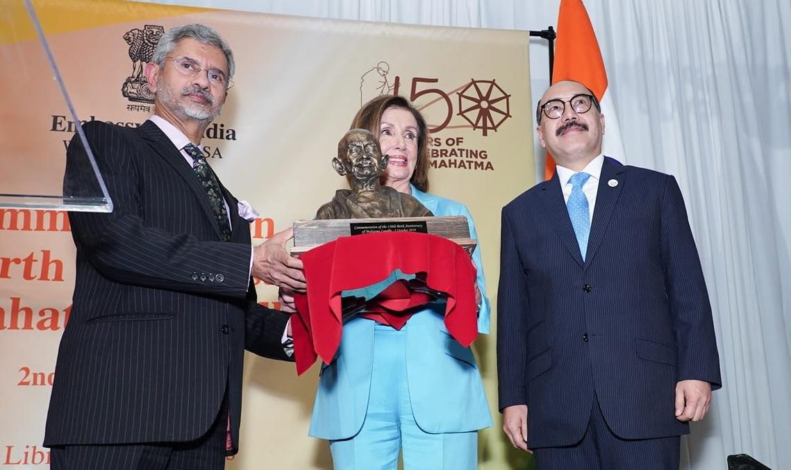 House Speaker Nancy Pelosi receiving a bust of Mahatma Gandhi from India's External Affairs Minister S. Jaishankar
