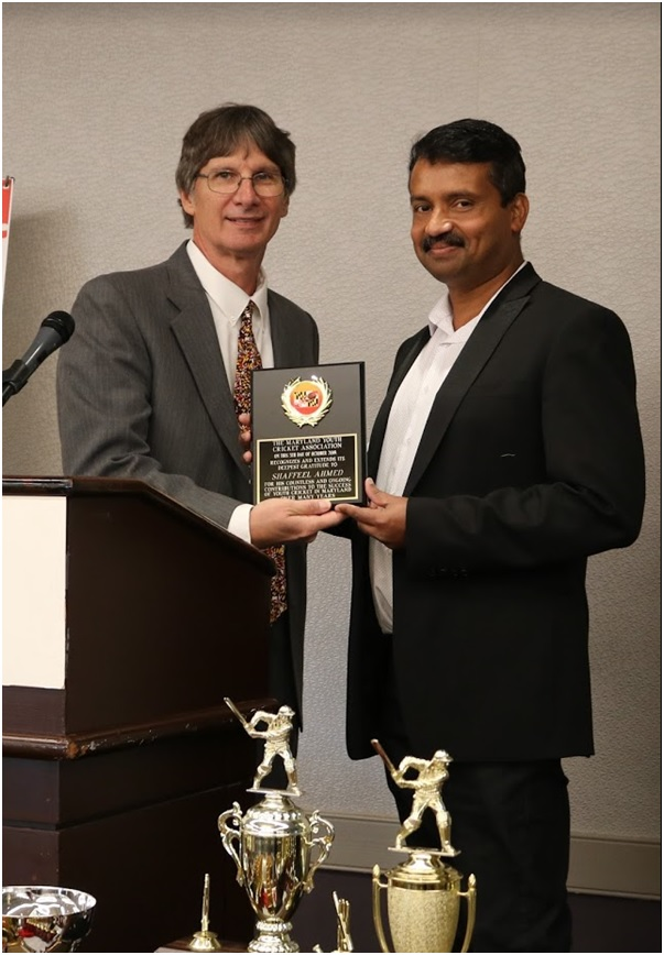 MYCA Chairman Jamie Harrison felicitating Shaffeel Ahmed, a member of the MYCA board of directors and scheduling and stats committee chair, for his contributions to the organization at its third annual banquet in College Park, MD on October 5.