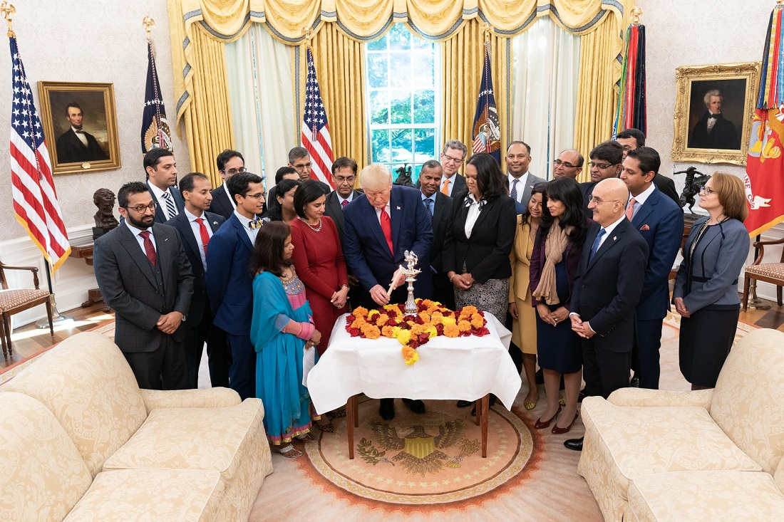 President Donald Trump lighting the Diwali 'diya' in the Oval Office, surrounded primarily by Indian-Americans serving in his administration. It is the third consecutive year that the president has celebrated the popular Indian festival of lights in the White House.