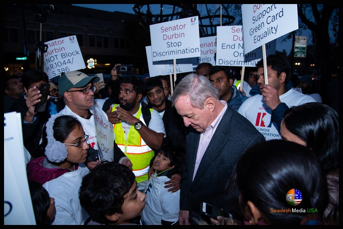 Sen. Dick Durbin is surrounded by Indian nationals stuck in Green Card backlog.