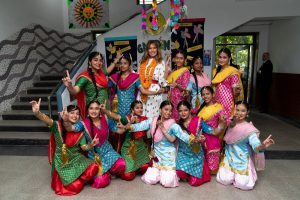 First Lady Melania Trump is flanked by exuberant students who danced to Bhangra beats during her visit to the Sarvodaya Co-Educational Senior Secondary School in New Delhi. Official White House Photo by Andrea Hanks