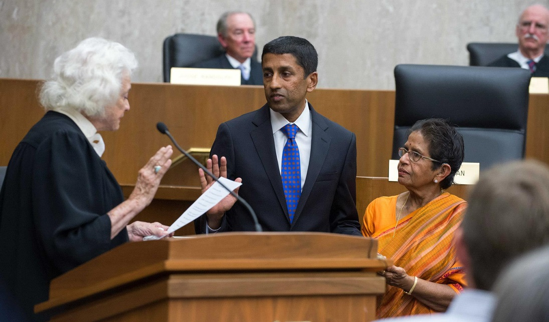 Sri Srinivasan taking the oath of office to serve as judge on the US Court of Appeals for the DC Circuit on the sacred Bhagavad Gita held by his mother Mrs. Saroja Srinivasan (right). Retired Supreme Court Justice Sandra Day O'Connor (left) administered the oath on September 26, 2013. Photo credit: Embassy of India, Washington
