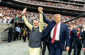 President Donald Trump holds hands with Prime Minister Narendra Modi as they take a surprise walk together around the NRG Stadium in Houston, Texas. Official White House Photo by Shealah Craighead