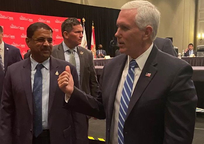 Indian American hotelier Danny Gaekwad (left) with Vice President Mike Pence in Orlando on Wednesday. Gaekwad represented AAHOA at a roundtable of business leaders hosted by Pence on reopening the economy.