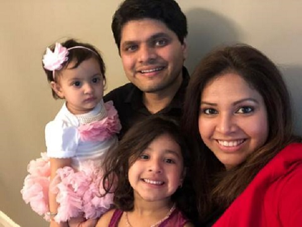 Poorva Dixit, with her husband, Kaustubh Talathi, and their two children. Dixit is one of the more than thousand nonimmigrant visa holders currently stranded in India.