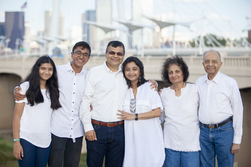 Vishakha Sheth (second from right), with her husband, Prakash, (right), their daughter Sejal Desai (third from right), son-in-law and grandchildren.