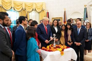 President Donald Trump lights a Diwali 'diya' (lamp) in the Oval Office surrounded by Indian-Americans serving in his administration. Official White House Photo by Joyce N. Boghosian; October 24, 2019