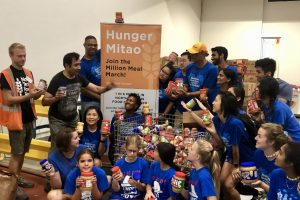 Raj Asava with volunteers and participants of the Hunger Mitao program.