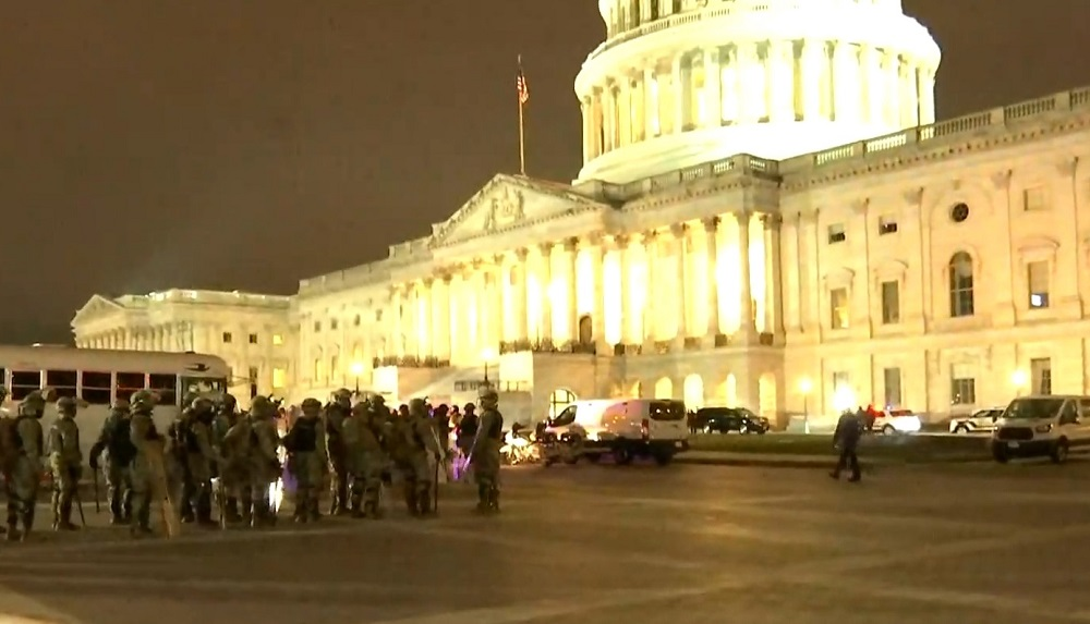 Law-enforcement officials in riot gear guarding the Capitol Hill building on Wednesday evening after it was overran by Trump supporters. Image via C-SPAN