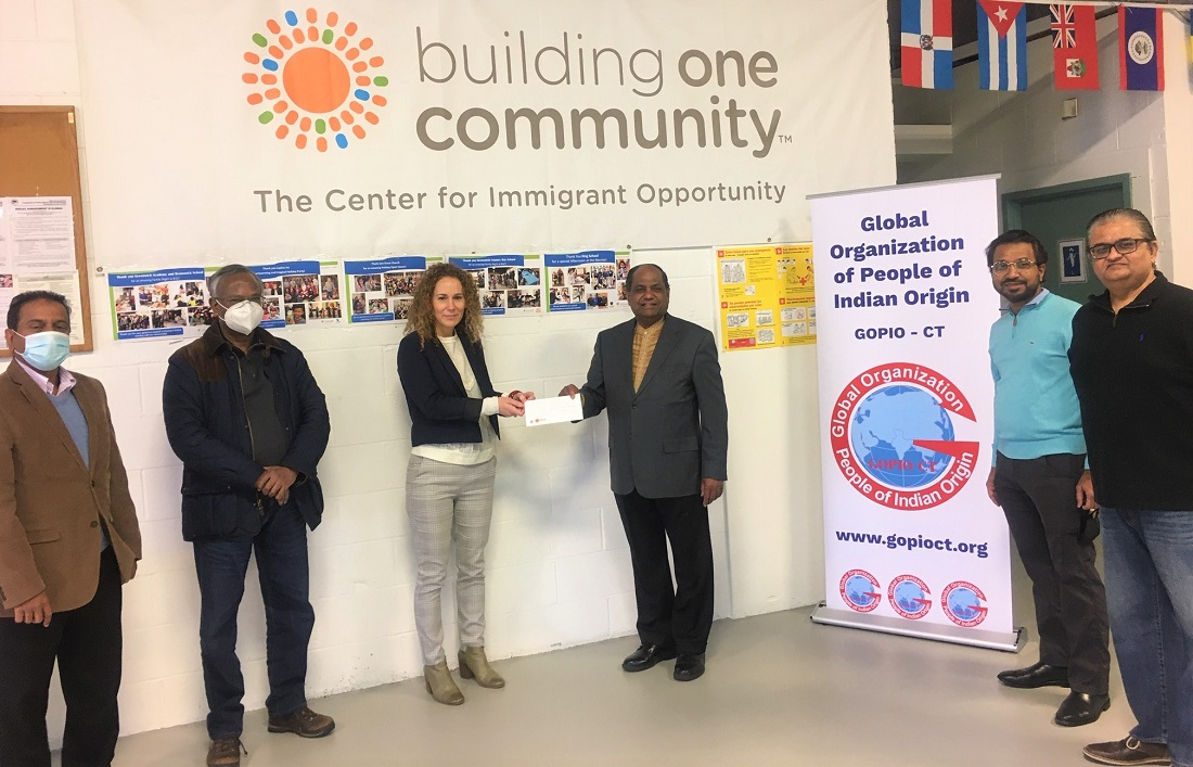 GOPIO-CT Chapter officials presenting a check to Stamford based Building One Community. From l. to r. GOPIO-CT Executive VP Prasad Chintalapudi, Trustee Joe Simon, B1C Executive Director Dr. Anka Badurina, Trustee and Comptroller Dr. Thomas Abraham and Board members Srinivas Akarapu and Rajneesh Misra