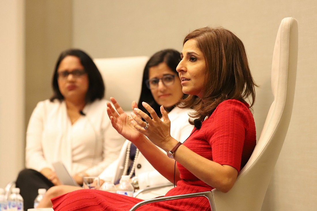 Neera Tanden (right), President Joe Biden's nominee to head the White House budget office, is seen here speaking at a 2018 'Women Who Impact' event in Washington, DC. Also pictured are Seema Nanda (center), head of the Democratic National Committee (DNC) at the time, and Indian American Impact Fund board member Mini Timmaraju. Photo credit: IMPACT