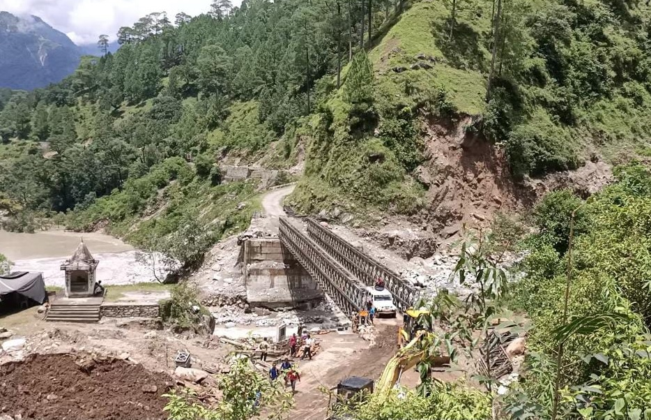 Uttarakhand glacial burst - A 50-meter concrete bridge in Pithoragarh, Uttarakhand, was rebuilt after being swept away in flood and landslide. The ecologically sensitive and fragile hills of Uttarakhand have seen massive construction activities in recent decades. Photo credit: PIB