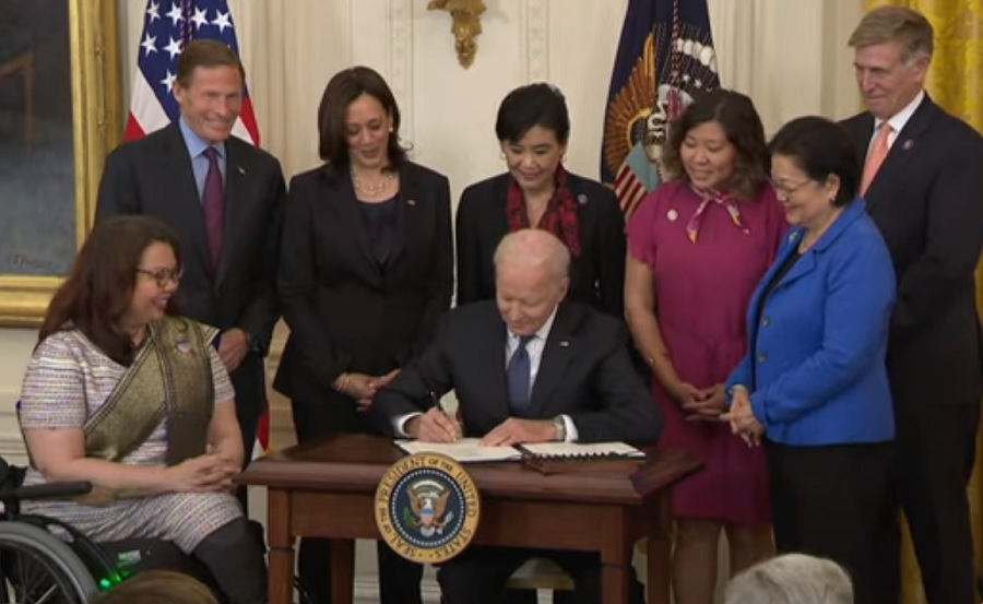 President Joe Biden signing the COVID-19 Hate Crimes Act at the White House on May 20, 2021.