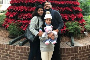 Payal Raj with her husband and daughter