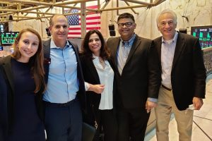 Executives of the newly formed UpHealth, Inc. pose for a photo with Paul Dorfman (second from left), Head of Listing at NYSE, on June 20, 2021. Others on the photo are Mariya Pylipiv, Chief of Strategy (left); Richa Sana, Chief Monitoring & Budgets (center); Dr. Syed Sabahat Azim, CEO International (second from right); and Dr. Adam Sky, Head of Behavioral Health (right).