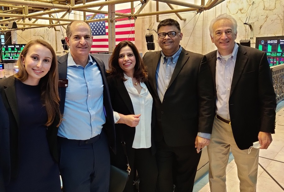 Executives of the newly formed UpHealth Holdings, Inc. pose for a photo with Paul Dorfman (second from left), Head of Listing at NYSE, on June 10, 2021. Others on the photo are Mariya Pylypiv, Chief Strategy Officer (left); Richa Sana, Chief Monitoring & Budgets (center); Dr. Syed Sabahat Azim, CEO International (second from right); and Dr. Adam Sky, Head of Behavioral Health (right).